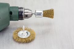 Electric drill with rotating metal brushes Royalty Free Stock Image