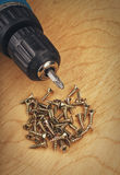 Electric drill and screws Stock Photo