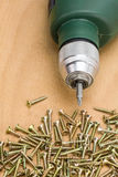 Electric drill with screws Stock Image