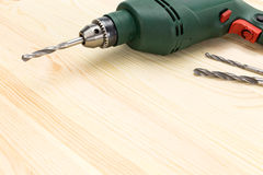Electric drill on wooden floor background Stock Photography