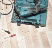 Electric drill on wooden floor Royalty Free Stock Photography