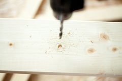 Electric drill and wooden plank Royalty Free Stock Photography