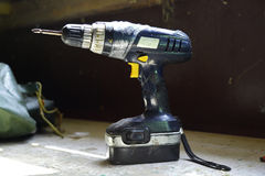 Electric drill on a wooden table royalty free stock photos