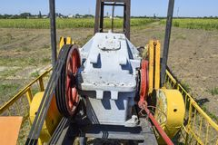 Electric drive and reducer   pumping unit of an oil well. Electric drive and reducer of the pumping unit of an oil well. Equipment of oil fields Royalty Free Stock Image