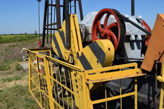 Electric drive and reducer  pumping unit of an oil well. Royalty Free Stock Images