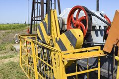 Electric drive and reducer  pumping unit of an oil well. Electric drive and reducer of the pumping unit of an oil well. Equipment of oil fields Royalty Free Stock Photos