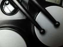 Electric drums with black plastic drum sticks. Close-up stock photo