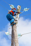 Electric eliminates the accident at the power line pole stock photography