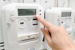 Electric energy meter. Electrical technician servicing unit Royalty Free Stock Photo