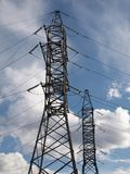 The electric energy towers. Two electric energy transmision towers Stock Photo