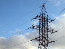 Electric energy transfer. Metalic mast for high voltage electric energy transmision Royalty Free Stock Photo