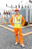 Electric engineer standing substation royalty free stock photography