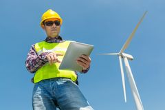 Free Electric Engineer Use Digital Wireless Tablet Device With Wind T Stock Photography - 111392752