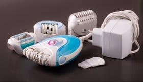 Electric epilator or depilator hair on a dark background Stock Image