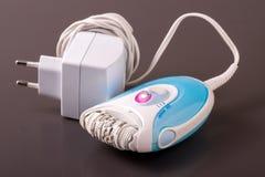 Electric epilator or depilator hair on a dark background Royalty Free Stock Image