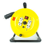 Electric extension cable reel on white Stock Photo