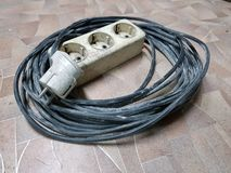 Electric extension for tiled floor royalty free stock image