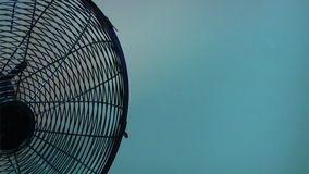 Electric fan background. Ultramarine background with half of working electric fan stock video footage