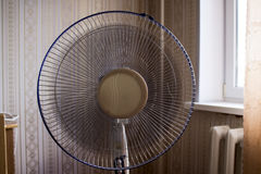 Electric fan in the room. Operated ventilator Royalty Free Stock Image