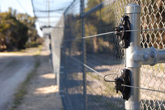 Electric fence. Park fence with electric security Stock Image