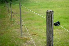 Electric fence around farm / horse paddock.  stock photos