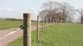 Electric Fence in Countryside Field - Natural Wild English Backgrounds stock video footage