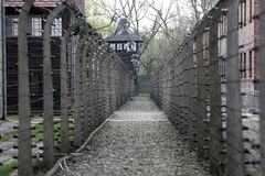 Electric fence in former Nazi concentration camp Auschwitz I Stock Photo