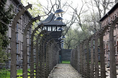 Electric fence in former Nazi concentration camp Auschwitz I Stock Photos