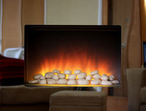 Electric fire with mirror surround. Electric flame fire with mirror surround royalty free stock image
