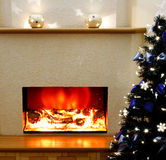 Electric fireplace  with the Christmas tree Royalty Free Stock Photos