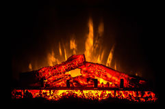 Electric fireplace with orange and yellow fire flame Stock Photography