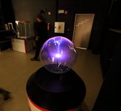 Electric flash generator in the glass sphere Stock Photos