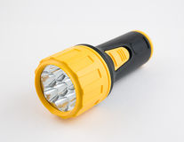 Electric flashlight. Black and yellow electric flashlight Royalty Free Stock Image