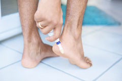 Electric foot scrubber being used in pedicure Royalty Free Stock Images