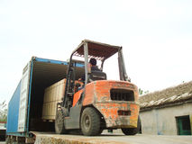 Electric Forklift Loading Cargos into Container Stock Photography