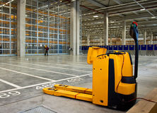 Electric forklift in storehouse Stock Photo