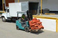 Electric forklift truck with bags Stock Images