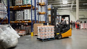 Electric forklift working in a warehouse stock video