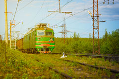 Electric Freight Train Approaching Polyarnye Zori, Russia. Electric freight train crossing the Russian countryside as it approaches Polyarnye Zori, in the Royalty Free Stock Photo