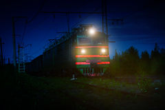 Electric Freight Train Approaching Polyarnye Zori, Russia, at Ni Royalty Free Stock Photos