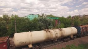 Electric freight train, locomotive moves rides by rail with wagons, transportation, transports wood, timber, logs. Deliver container, transports cargo in city stock footage