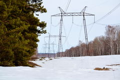 Electric full tilts. Electric high-tension full tilts is pulled through steppe Altaya Stock Image