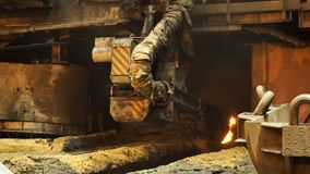 Electric furnace for smelting liquid steel at the metallurgical plant. Stock footage. Close up for the working machine. Electric furnace for smelting liquid stock photo
