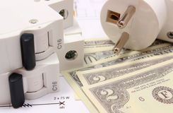 Electric fuse and plug, money on electrical drawing, energy concept Stock Images