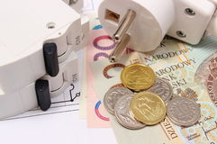 Electric fuse and plug, money on electrical drawing, energy concept Stock Photo