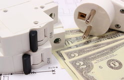 Electric fuse and plug, money on electrical drawing, energy concept Royalty Free Stock Image