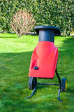 Electric garden shredder. Red electric garden shredder in a garden Stock Photos