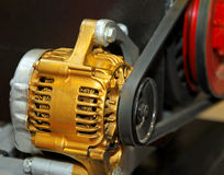 Electric generator. Golden alternator for electric generator in vehicle Royalty Free Stock Image
