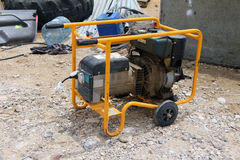 Electric Generator. Portable electric generator on the construction site Stock Images