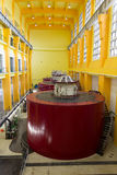 Electric generators. In hydro power plant machine hall Royalty Free Stock Photography